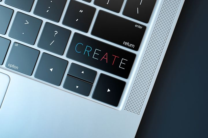Website Design: Laptop keyboard with the word CREATE on the enter key.